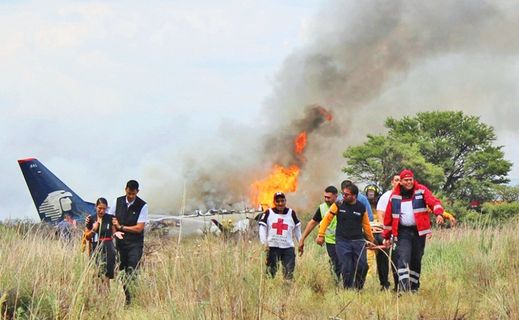 Investigators search for causes of Aeromexico plane wreckage