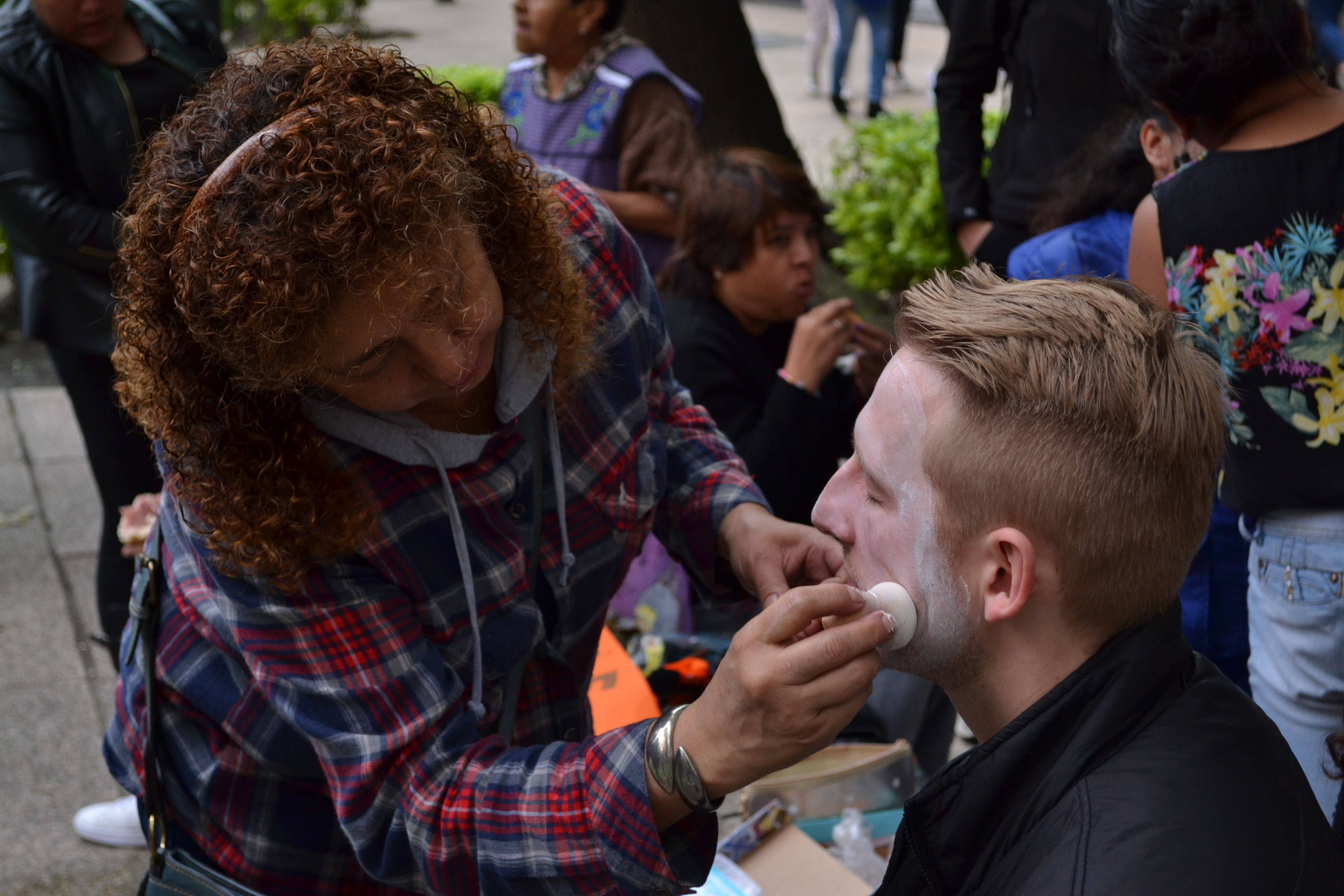 Both locals and foreigners had their faces painted as part of the tradition