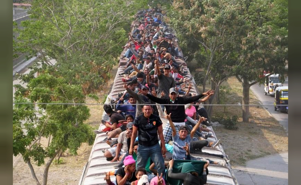 Hundreds of migrants in Mexico board 'The Beast' heading north