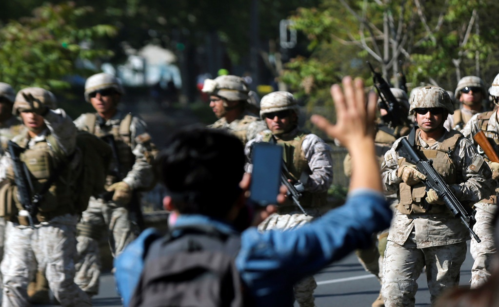 Chile suspends planned fare hike amid violent protests