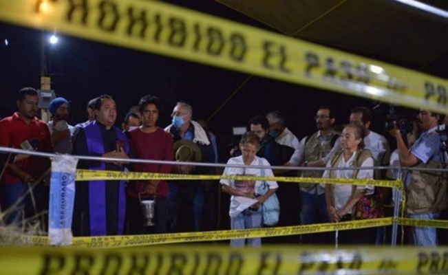 Mexico identifies 56 sets of human remains in mass grave