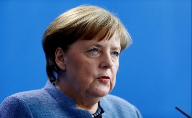 A divided Germany greets Merkel's last grand coalition