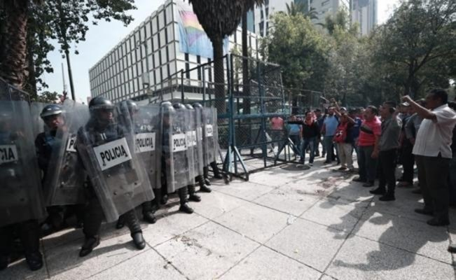 Police and protesters clash in front of the U.S. Embassy in Mexico City