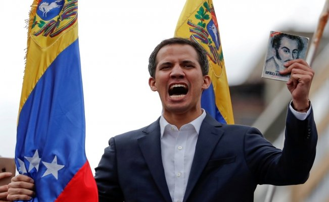 Buoyed by protesters, opposition leader Juan Guaidó claims Venezuela presidency