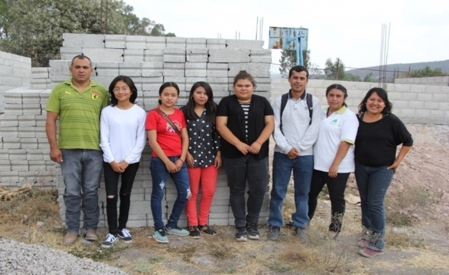 Students donate their scholarships to build new school