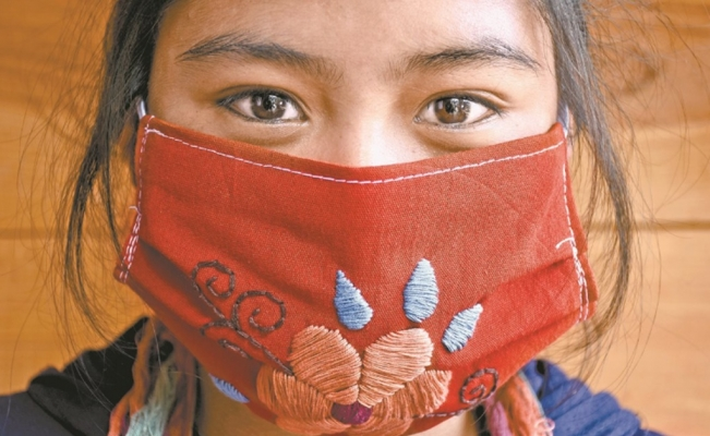 Mexican artisans make hand embroidered face masks for the COVID-19 pandemic