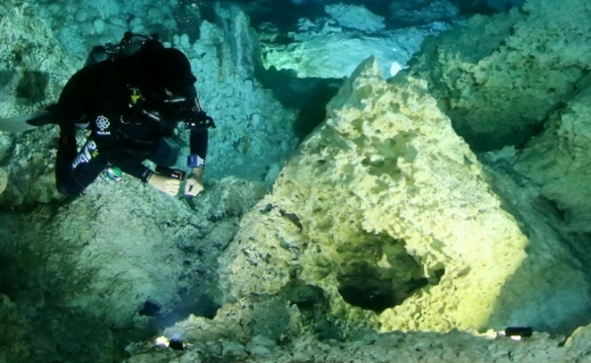 Mexican archeologists find ancient bonfires inside cenote in Quintana Roo