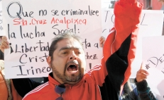 Protesters demand release of two activists accused of human trafficking in Mexico