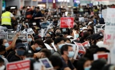 Chaos grips Hong Kong's airport as riot police charge protesters