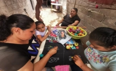 Mexican artisans embroider handmade masks for the COVID-19 crisis