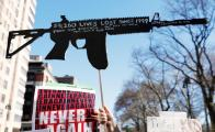 Massive crowds rally to urge tighter gun controls in the U.S.