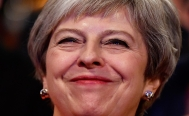 Theresa May survives confidence vote after Brexit defeat