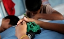 Despite migration laws, Mexico keeps migrant children in crowded detention centers