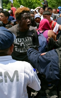 Mexican armed forces meets migrants at southern border