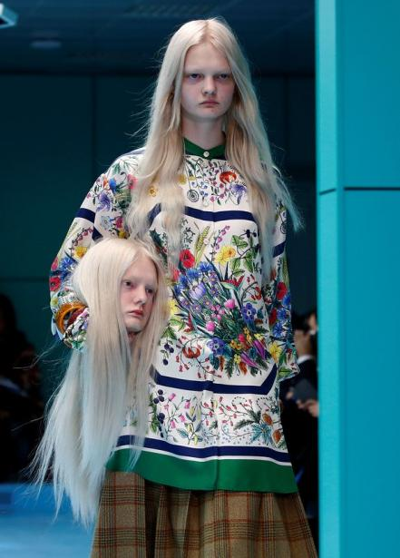 model-presents-a-creation-from-the-gucci-autumnwssssinter-2018-women-collection-during-milan-fashion-we.jpg