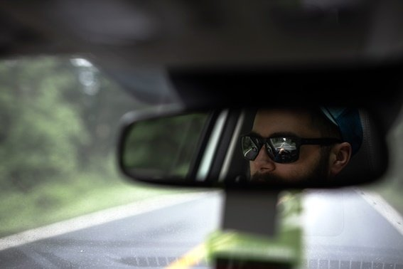 reflection-of-a-man-on-rear-view-mirror-2304794.jpg